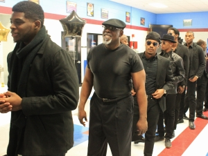 Images Modeling Troupe  and the men of Tabernacle line up for the men's all black casual scene.
