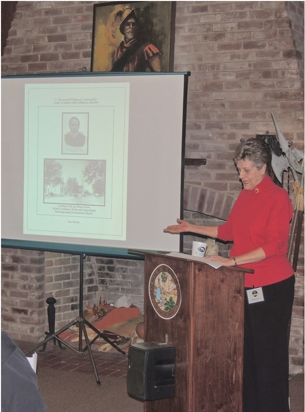 Photo by Navael Fontus Speaker Mary May gave brief descriptions of the images that accompanied her speech.
