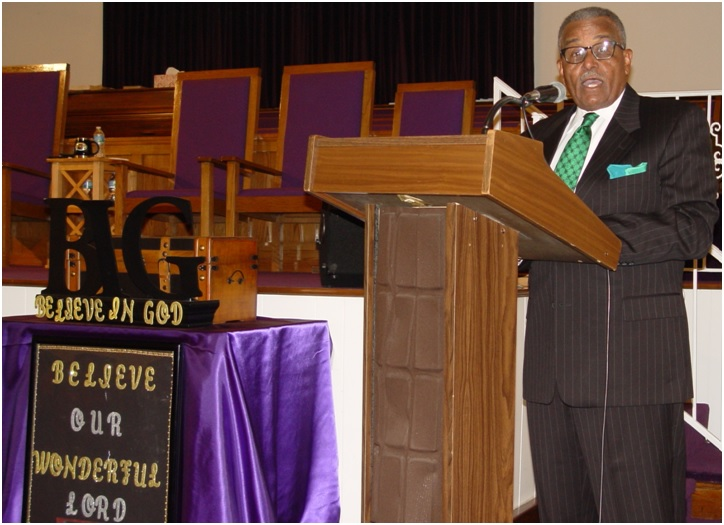 Deacon Charles A. Wright speaks during the Africare Heritage Day Program.