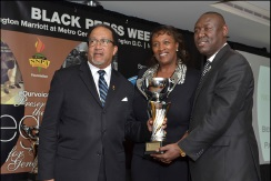NNPA Photo by Freddie Allen NNPA President and CEO Benjamin F. Chavis, Jr. (left) and Publisher Natalie Cole present the Newsmaker of the Year award to Attorney Ben Crump