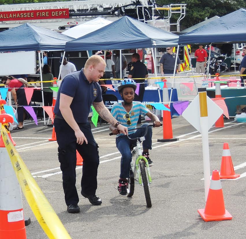 Photos by Navael Fontus Children learned the importance of bike safety with LCEMS workers at the safety fair.
