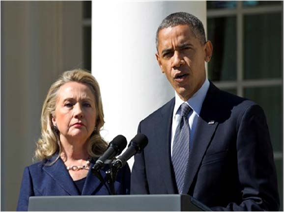 Photo courtesy of  AP Photo/Manuel Balce Ceneta, File In this Sept. 12, 2012 file photo, President Barack Obama, accompanied by then-Secretary of State Hillary Rodham Clinton, speaks in the Rose Garden of the White House in Washington. Rather than keeping him at arm's length, Hillary Rodham Clinton is embracing President Barack Obama, sometimes even literally. As she prepares for another presidential campaign, Clinton has aligned herself with Obama far more than she has disagreed with him. She had been expected to separate herself from the president to avoid appearing as though she'd simply carry out his third term.
