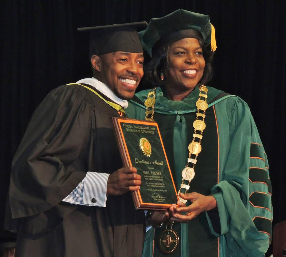 Photos by Devin Powell  Will Packer posed with FAMU President Elmira Mangum after  receiving the President's Award at the 2 p.m. commencement ceremony on May 2.