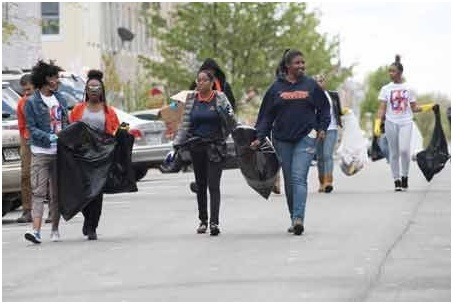 Photo courtesy of NNPA and Larry Morgan/Morgan State University Morgan students on their way to assist with the clean up of community in aftermath of riots.