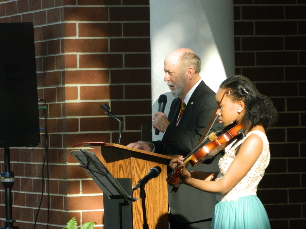 Peter Cowdrey, Volunteer at the Museum of History and Samantha Crawford Leon High School Violinist, who performed the Negro National Anthem is pictured above.