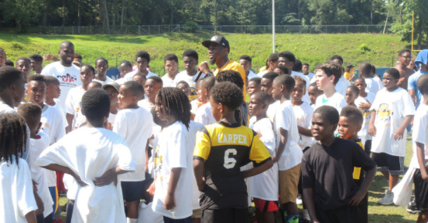 Gay Returns Home for Annual Football Camp