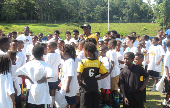 William Gay gathered young athletes of his football camp for a brief huddle. Photo by Christopher Bony