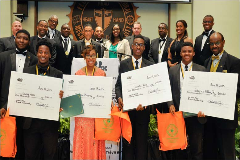 Kaycee Reese, Chelsea Murphy, Devonte King and Roderick Wilkins pose with checks they received from 100 Black Men Tallahassee, Inc. and scholarships from FAMU.  All will attend FAMU in the fall. They are flanked by members of 100 Black Men, corporate sponsors, and Natalie Rose, center back row, from the FAMU Scholarship Office.  Photo special to the Outlook