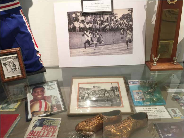 "The Robert ""Bullet Bob"" Hayes memorabilia wall in the Black Archives. Photo by Janelle Floyd"