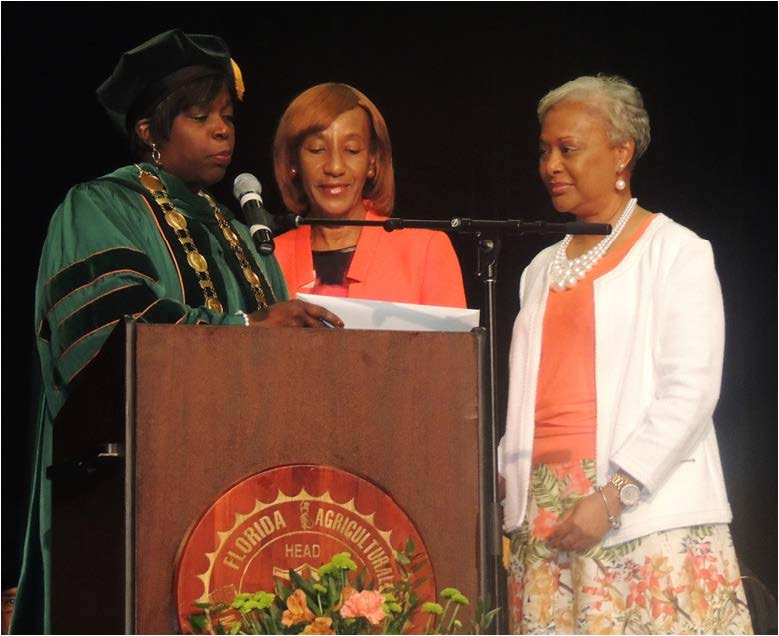 FAMU President Elmira Mangum presented the posthumous master's degree to the family of Aaron Goodwin.