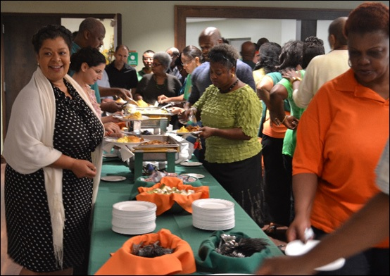 Reba Hartsfield (in polka dot dress) and other faculty and staff getting breakfast. Photos by Janelle Floyd