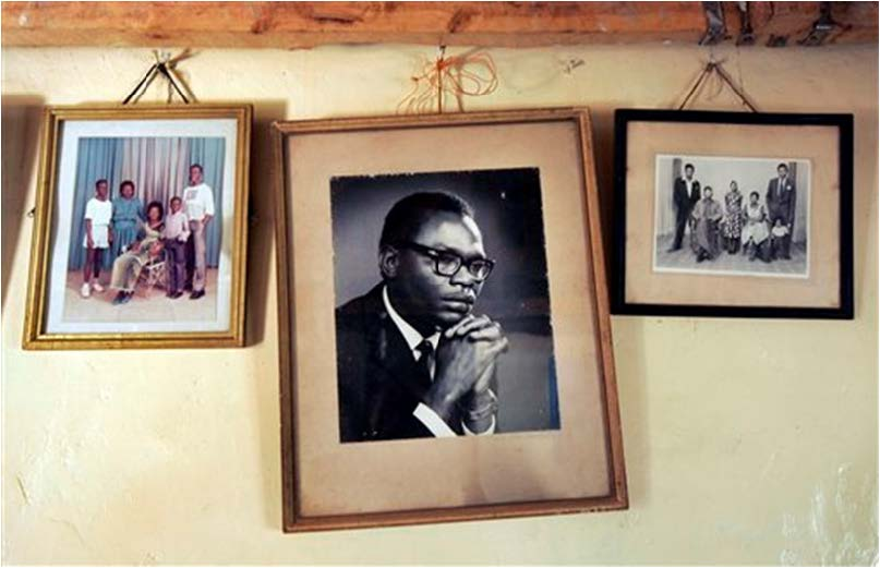 In this Thursday, Feb. 5, 2008 file photo, a photograph of Barack Obama Sr., father of President Barack Obama, hangs on the wall of his step-grandmother Sarah Obama's house in the village of Kogelo, near the shores of Lake Victoria, in Kenya. On Friday, July 24, 2015 Obama was due to arrive in Kenya, the country of his father's birth, for the first time since he was a U.S. senator in 2006, and the first stop on his two-nation African tour in which he will also visit Ethiopia.  AP Photo/Ben Curtis, File
