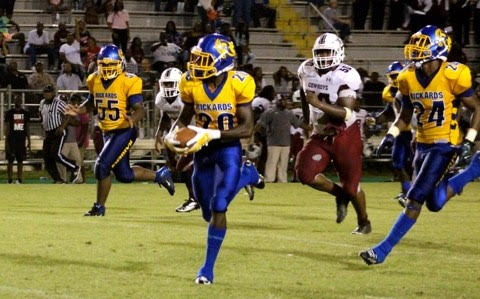 Receiver Chad Hunter stays a few steps ahead of a lone Madison County defender, as he head to the endzone with the game-winner on a 36-yard catch Saturday night at Cox Stadium. Photo by Idris Smith