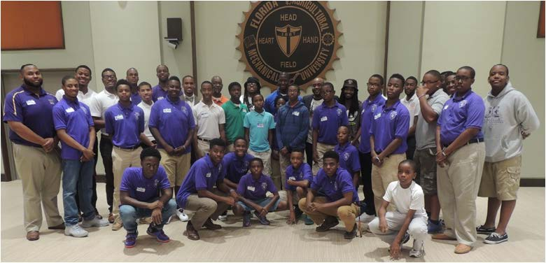 Tallahassee youth posed for a picture along with Tallahassee Mayor Andrew Gillum, Florida House Rep. Alan Williams, Mr. FAMU Imir Hall and other contributors to the Tallahassee Gentleman's Quarterly.
