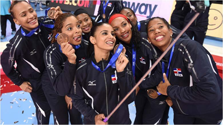 FAMU's outside hitter Pamela Soriano, second left, and her Dominican Republic teammates celebrate their bronze medal win over Japan at the recent under-23 volleyball championships. Photo courtesy of FAMU Athletics