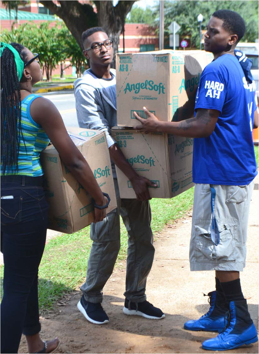Fraternity members helped incoming freshmen move into FAMU Villages.