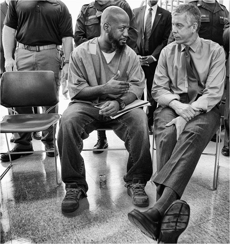 Education Secretary Arne Duncan speaks with a participant in the Goucher College Prison Education Partnership at the Maryland Correctional Institution.  Photo courtesy of Flickr/Department of Education/CC.