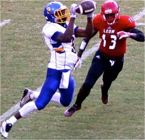 Receiver Marcus Riley pulls in a pass from Rickards' quarterback D.J. Phillips for a big gain against Leo