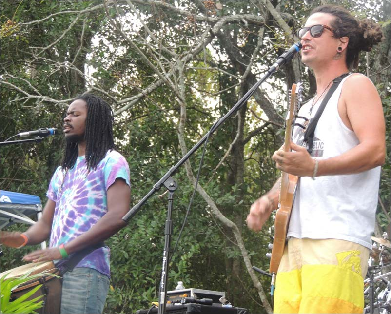 "Members of the rock band "" Sway Jah Vu"", drummer Terrell Sermon (left) amd lead vocalist  Travis Cockerham (right) performed on stage at the event."