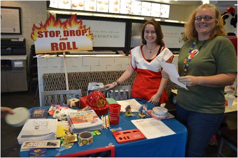 Two Red Cross members passed out fliers on fire safety. Photo by  Janelle Floyd