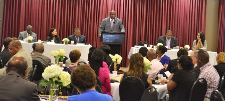 An audience of more than 50 community members  listened attentively  to   keynote speaker, Attorney Daryl Parks.   Photos by Janelle Floyd