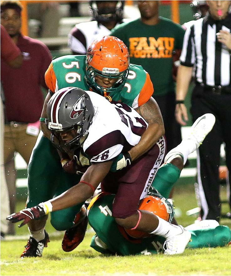 FAMU linebacker Kashawn Butler takes down running back Ramone Simpson of North Carolina Central during their game Saturday at Bragg Stadium. John Boston also assisted on the tackle.  Photo by Vaughn Wilson/FAMU athletics