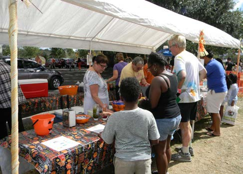 Customers in line to purchase the food presented for the market place. Photos by Lavonte Dukes