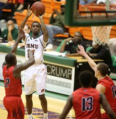 Justin Ravenal shoots over Marcus Johnson of Samford for one of his six 3-point shots in FAMU's loss on Saturday. Photo courtesy of Vaughn Wilson/FAMU athletics