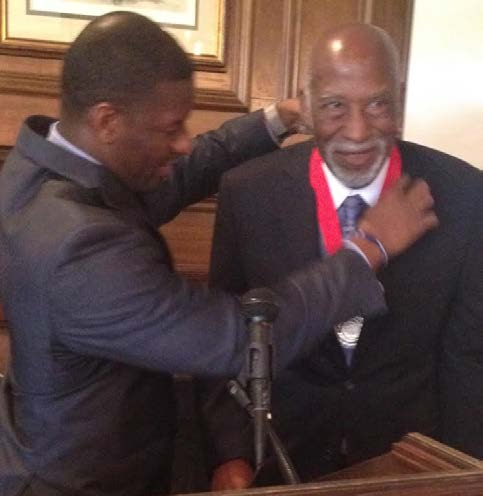 Current Mayor Andrew Gilliam presents an honorary medallion to James Ford, the first Black mayor in Tallahassee, during his birthday celebration last weekend. Photo by St. Clair Murraine