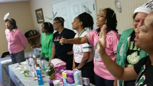 Members of Chi Upsilon Omega Chapter of Alpha Kappa Alpha Sorority, Inc. singing Christmas Carols.  Photos  by Joy Williams (Top and Bottom Right)