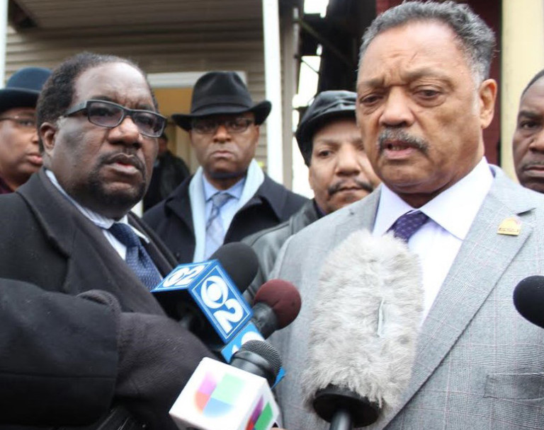 Rev. Jesse Jackson and Rev. Marshall Hatch talk to reporters on the sidewalk in front of Jones' home. Hatch recently met with Chicago Mayor Rahm Emanuel about police killings of African Americans.  Photo by Owen Lawson, III