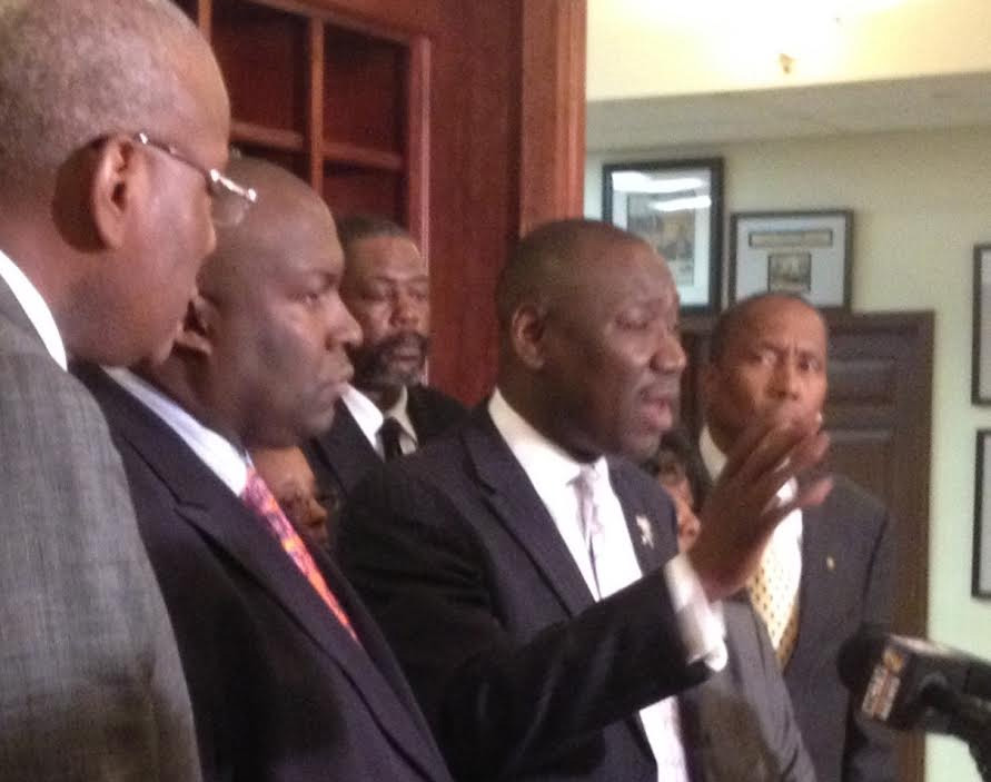 Flanked by members of Barbara Dawson's family, attorney Benjamin Crump outlined details of  the video  leading up to her death. Photo by St. Clair Murraine