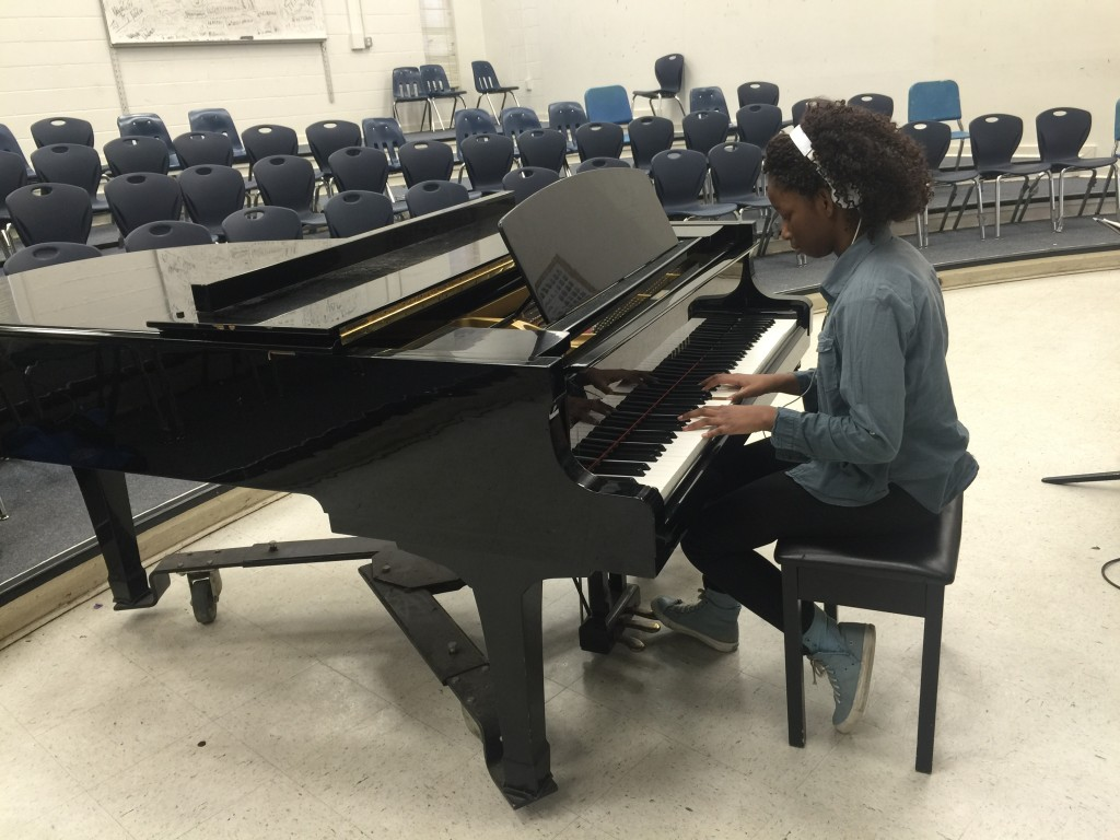 Lauryn Brown plays the piano in Godby Orchestra. Photo by Stephanie Chioma Davis