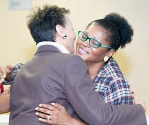 Delores Young-Hayes, keynote speaker and attendee hugged during the event. Photo by Towanda Davis