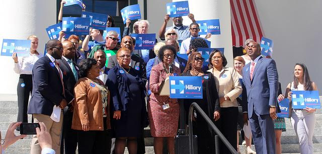 Dean of the Florida Black Caucus State Senator Arthenia Joyner reviews Hillary Clinton's record of commitment to African Americans with colleagues on the steps of the Old Capitol.  Photo special to the Outloo