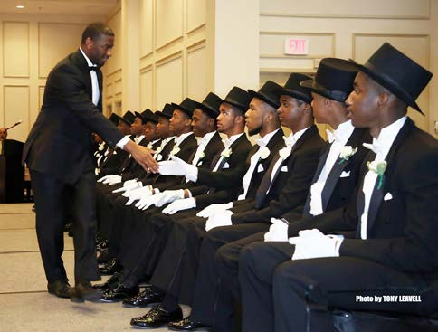 Tallahassee Mayor Andrew Gillum congratulates and shakes the hands of the 17 Links Beautillion Beaux