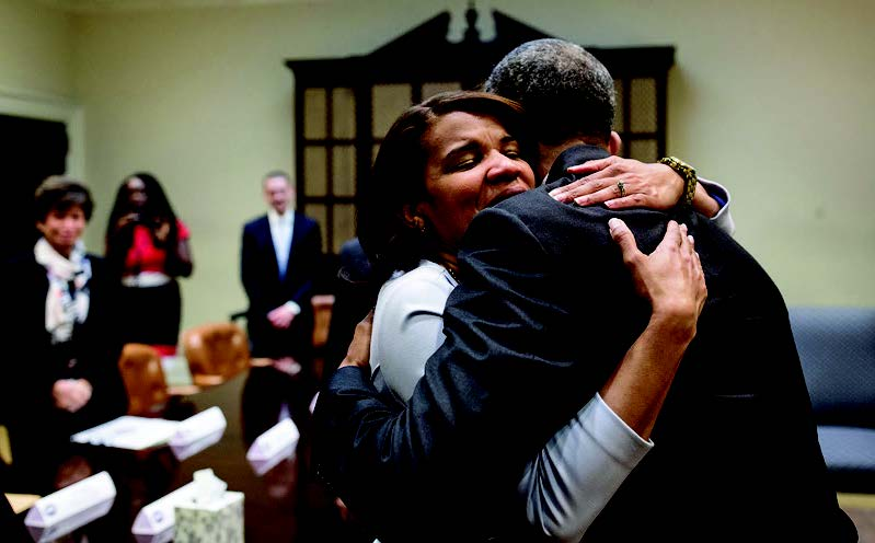 President Barack Obama hugs Kemba Smith during a greet with formerly incarcerated individuals who have received commutations, in the Roosevelt Room of the White House, March 30, 2016.