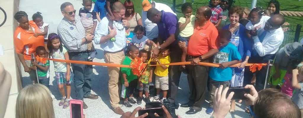 Mayor Andrew Gillum gets some assistance from a group of pre-school students during Friday's ribbon-cutting ceremony on FAMU Way.