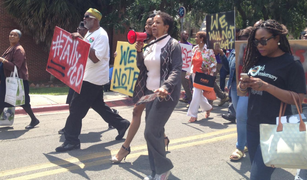 Marchers make their way to Lake Anita where ceremonies were held to celebrate the 60th anniversary of a bus boycott led by FAMU  students Wilhelmina Jakes and Carrie Patterson. Photo by St. Clair Murraine