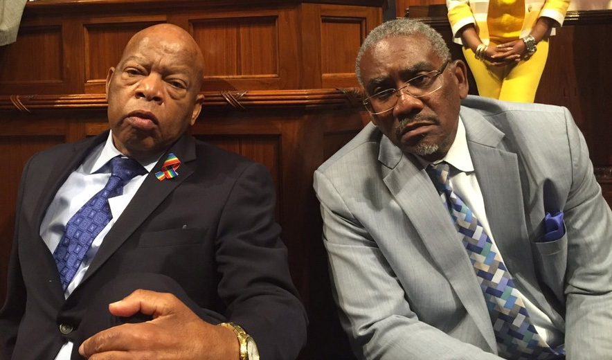 U.S. Rep. John Lewis sits with U.S. Rep. David Meeks (D., N.Y.) Photo courtesy of NNPA