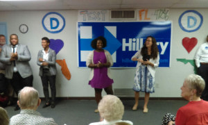 Regional organizing directors Tierra Ward (left) and Sarah Brandon (right) welcome the crowd to the grand opening of Clinton's campaign office.