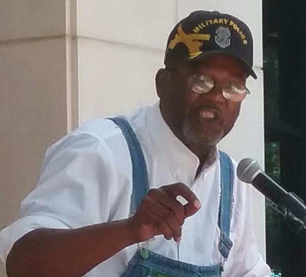 Dale Landry, president of the Tallahassee branch of the NAACP, makes an appeal for laws that would oversee police action. Photo by St. Clair Murraine