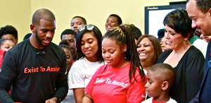 NBA Superstar Chris Paul (left) partnered with State Farm and Jordan Brand's WINGS to donate a computer lab. Photo courtesy of NNPA