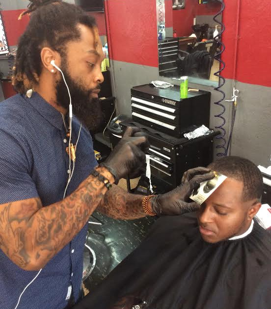 Gerrod Russ has made a fast rise as one of Tallahassee's most popular barbers. Photo by Damon Arnold
