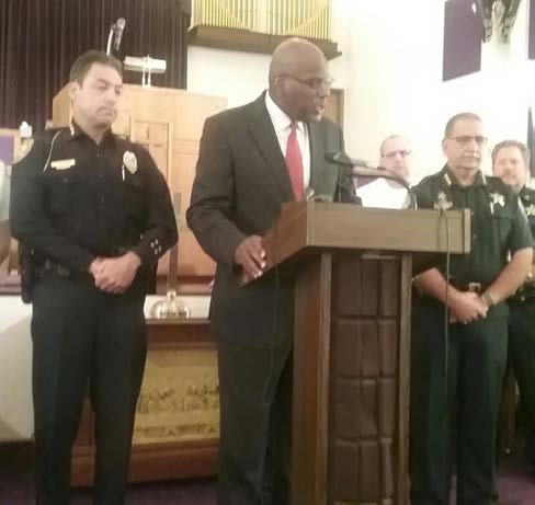Tallahassee Police Chief Michael DeLeo, left, and Leon County Sheriff Mike Wood, right, joined Rev. R.B. Holmes, center, at a Tuesday press conference to kick off Solidarity Weekend. Photo by St. Clair Murraine