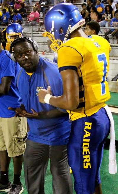 Rickards head coach Quintin Lewis, left, gives quarterback D.J. Phillips some advice after he threw an interception against Bay High School this past Friday night at Cox Stadium. Photo courtesy of Idris Smith