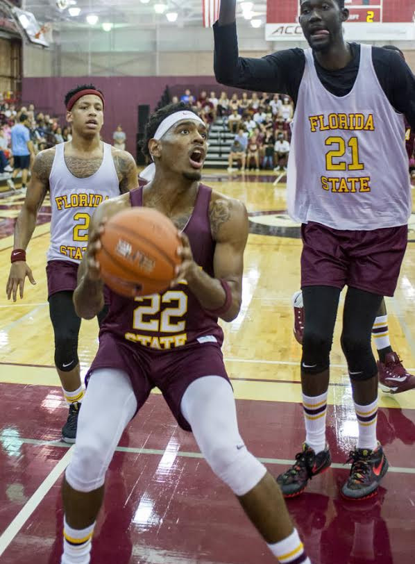 Xavier Rathan-Mayer sets for a layup as Michael Ojo (right) towers over him during Friday's Jam With Ham. Photo courtesy FSU athletics
