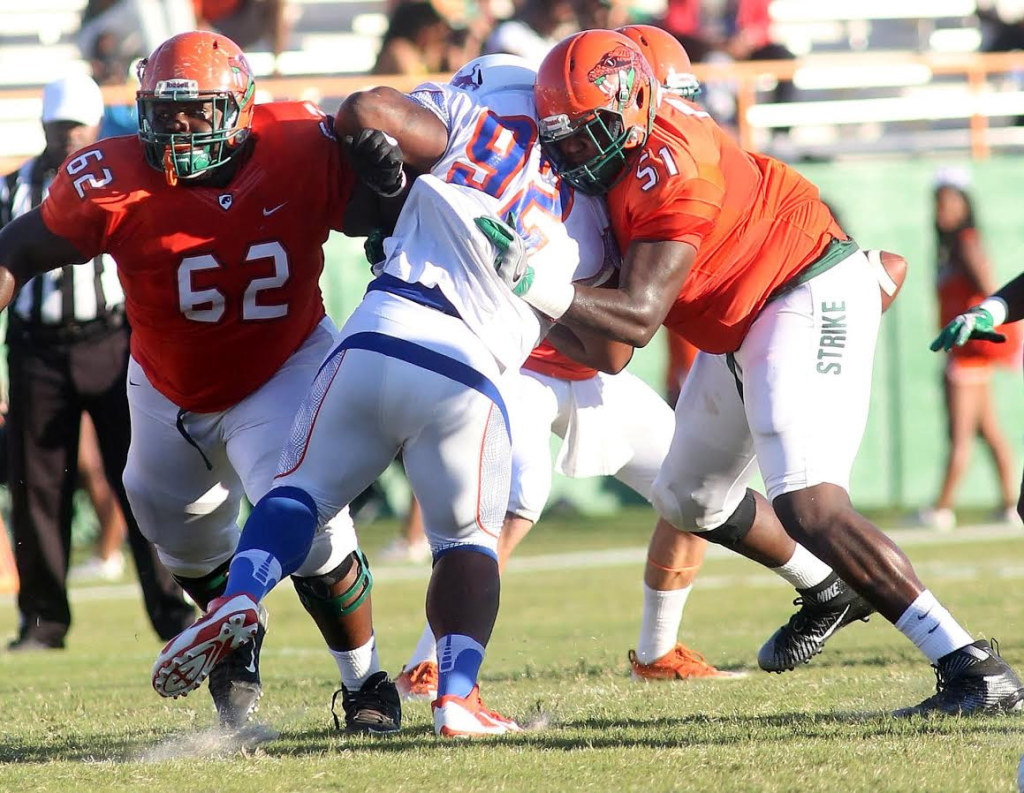 Savannah State's defensive tackle Brandon Carswell finds it tough to get past offensive linemen Keonte Cash (left) and T.J. Jones early in Saturday's game a Bragg Stadium. Photo courtesy FAMU Athletics Dept.
