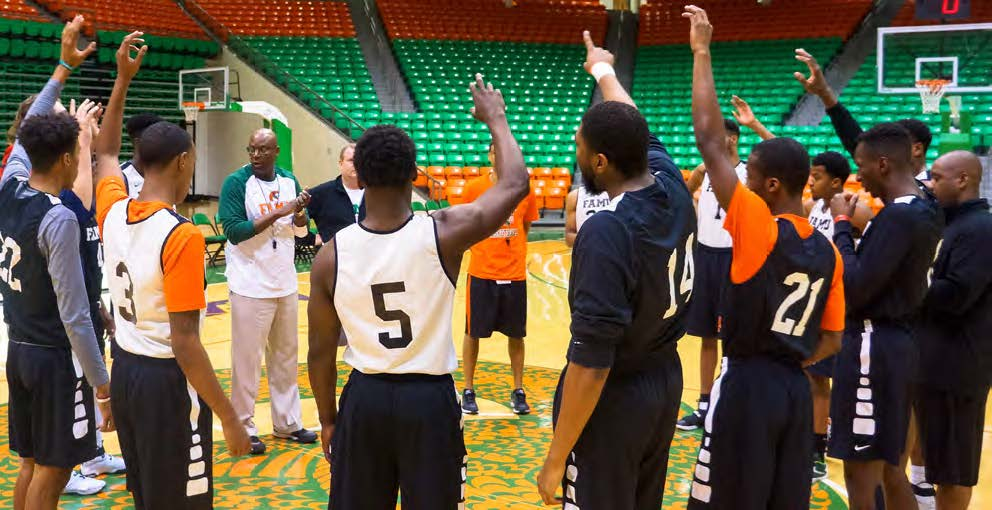 Coach Byron Samuels breaks down the details for his men's basketball team during a recent practice at the Lawson Center.