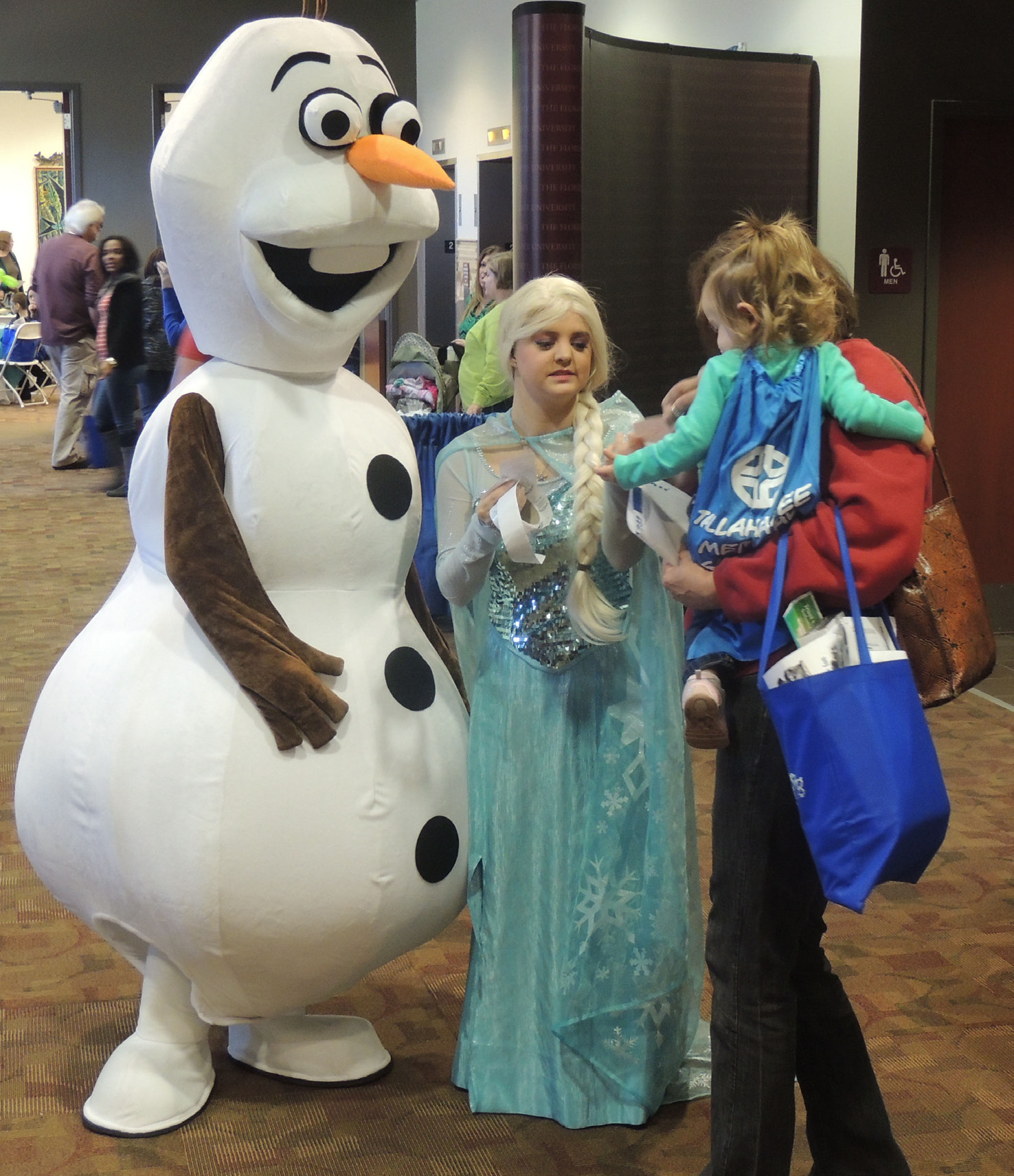Photos by Navael Fontus Elsa and Olaf greeted and took pictures with the excited kids at the family and baby fair.